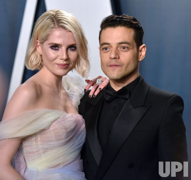 Lucy Boynton and Rami Malek attend Vanity Fair Oscar party