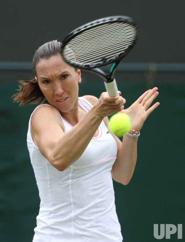 Jelena Janckovic returns at Wimbledon.