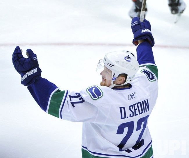 Canucks Sedin celebrates goal against Blackhawks in Chicago