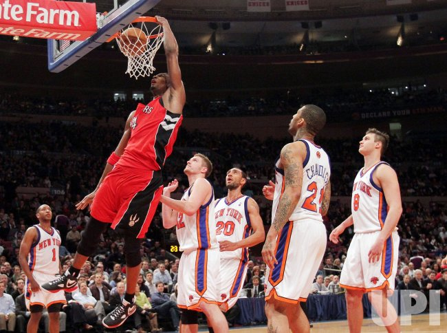 Toronto Raptors Chris Bosh dunks in the second quarter against the New York Knicks at Madison Square Garden