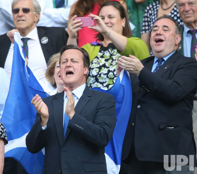 British Prime Minister David Cameron celebrates at the Wimbledon Championships in London