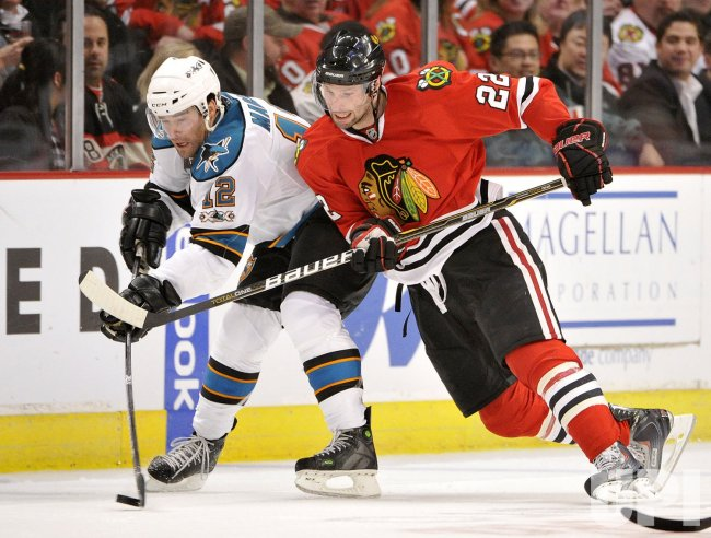 Blackhawks Brouwer checks Sharks Marleau in Chicago