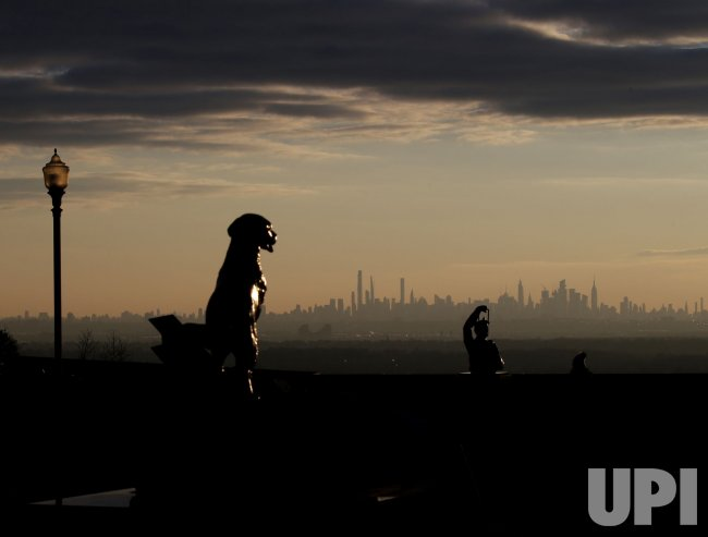 Sunrise Behind One World Trade Center and Manhattan Skyline