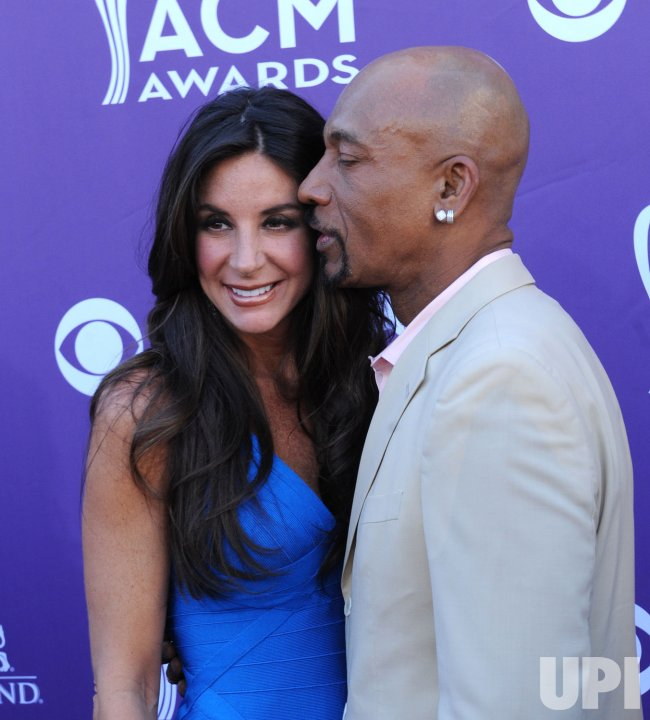 Tara Williams and TV host Montel Williams arrive at the Academy of Country Music Awards in Las Vegas