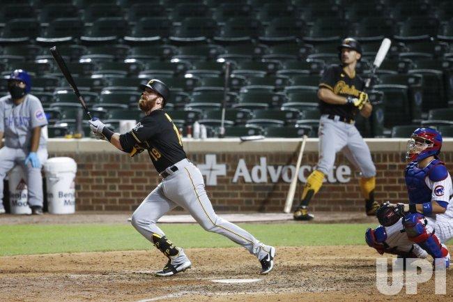 Pirates Colin Moran hits a solo home run at Wrigley Field in Chicago