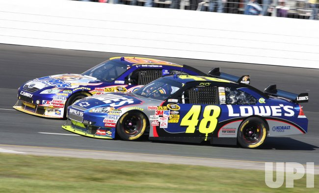 Jimmie Johnson makes a pass during the NASCAR race at Loudon, New Hampshire