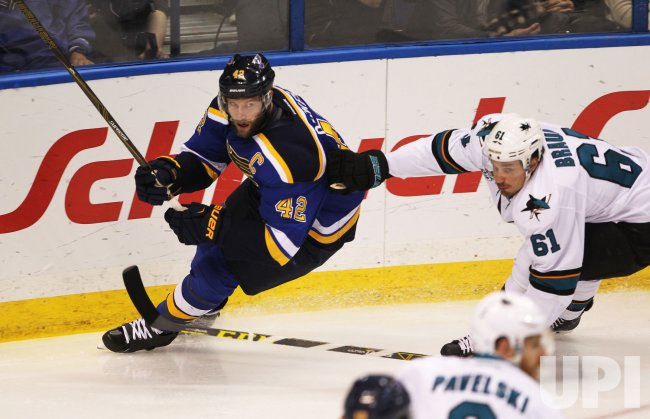 San Jose Sharks Justin Braun hangs onto St. Louis Blues David Backes in the NHL Western Conference Finals