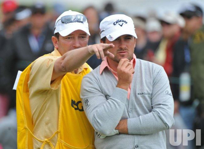 Graeme McDowell and his caddie Ken Comboy during the U.S. Open in Pebble Beach, California