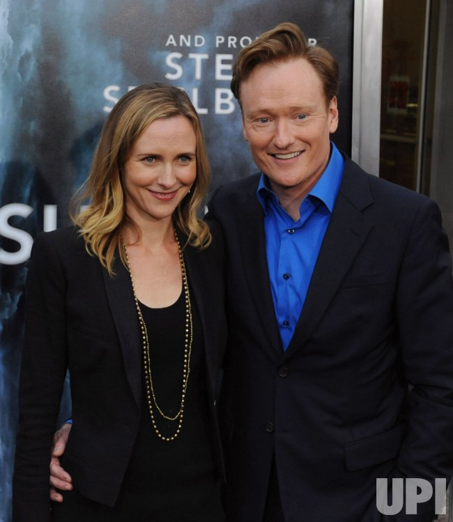 "Conan O'Brien and Liza Powell attend the ""Super 8"" premiere in Los Angeles"