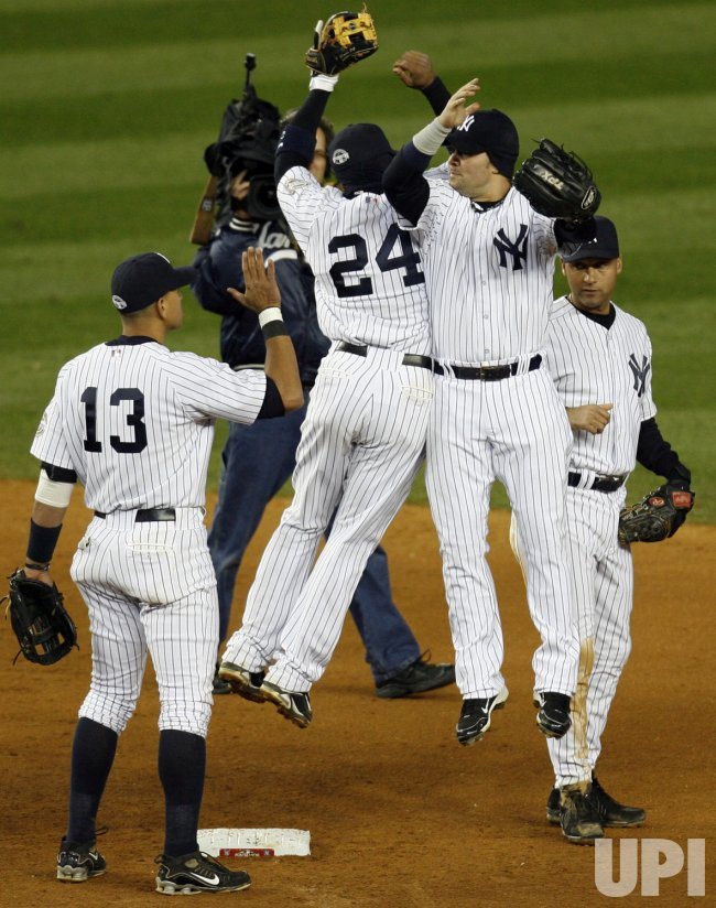 New York Yankees Alex Rodriguez, Robinson Cano, Nick Swisher and Derek Jeter react after the game against the Los Angeles Angels of Anaheim in game 1 of the ALCS at Yankee Stadium in New York