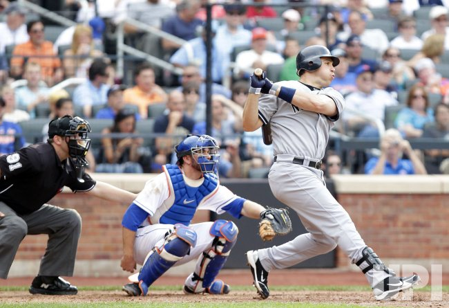 New York Yankees Mark Teixeira hits a single at Citi Field in New York