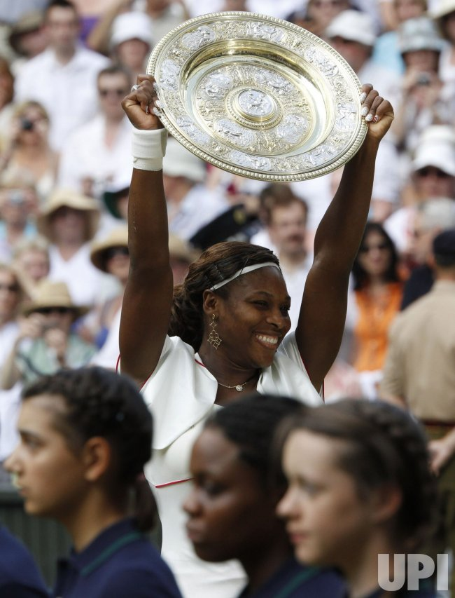 Williams holds winning trophy in the final at the Wimbledon Championships