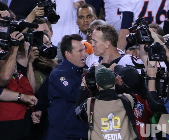 Denver Broncos Head Coach Gary Kubiak and Peyton Manning after win in Super Bowl 50