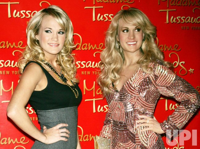 Carrie Underwood unveils her wax figure at Madame Tussauds in New York