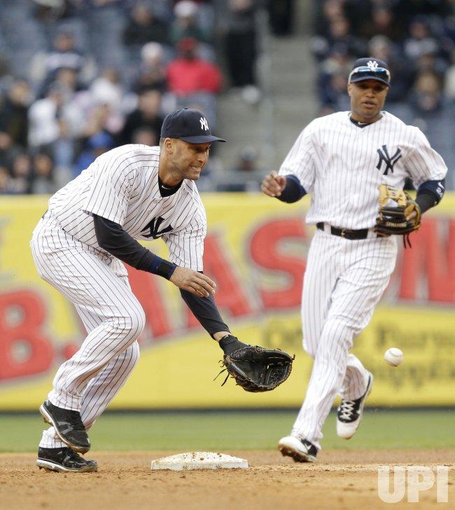 New York Yankees Robinson Cano watches Derek Jeter at Yankee Stadium in New York