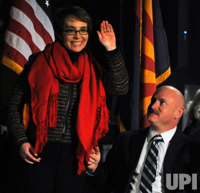 Giffords waves to crowd at vigil in Tucson, Arizona.