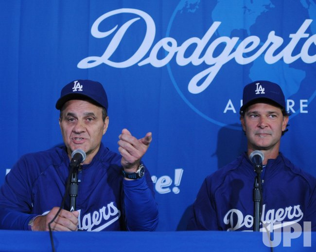 Joe Torre announces retirement as Dodgers manager and will be replaced by Don Mattingly in Los Angeles.