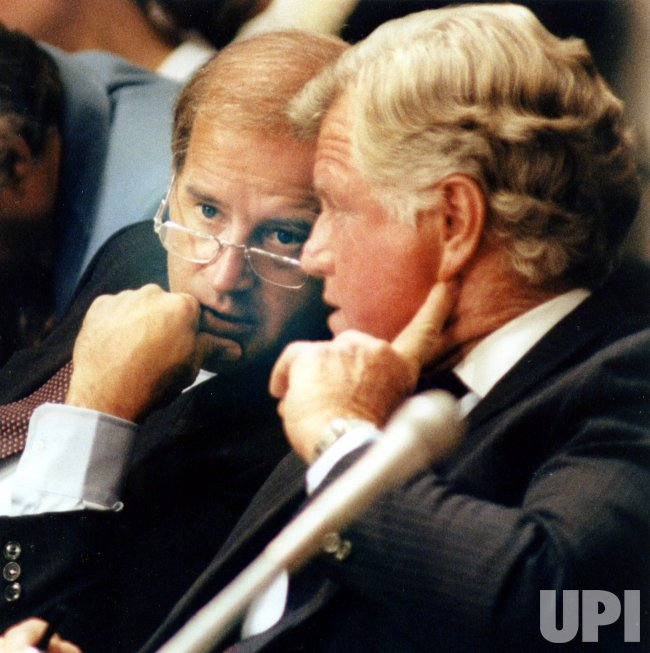 Senator Joseph Biden and Senator Edward Kennedy share a word during Supreme Court confirmation hearings.