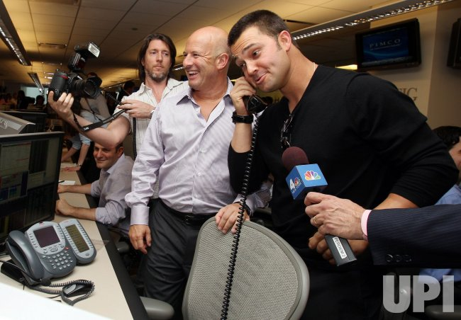 BTIG Co-Founder Steven Starker watches New York Yankees Nick Swisher say hello to a client at the 2010 BTIG Commissions for Charity Day in New York