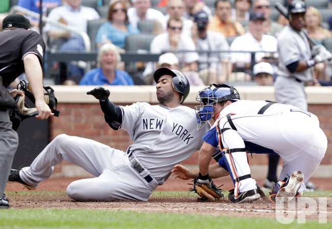 New York Mets Josh Thole tags out New York Yankees Eduardo Nunez at Citi Field in New York