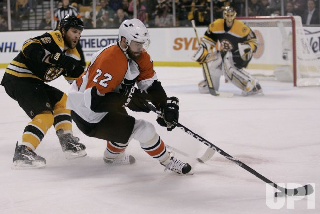 Flyers Hartnell scores against Bruins Rask in Game 5 of the NHL Eastern Conference Semi-Final in Boston, MA.