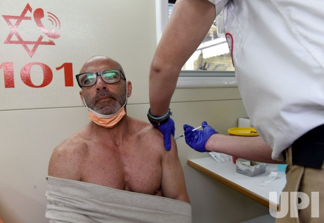 An Israeli Receives The Pfizer-Biotech Coronavirus Vaccine In Jerusalem