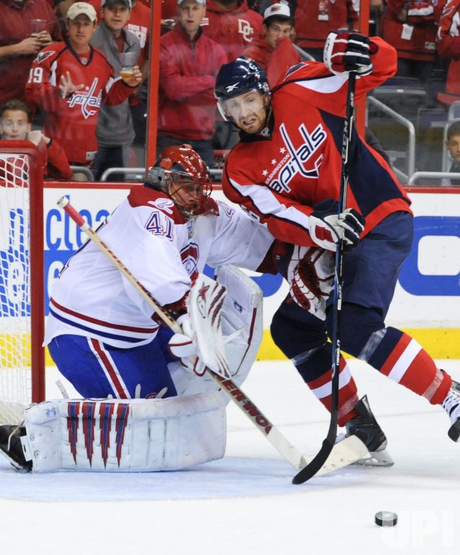 Canadiens Halak deflects shot by Capitals Fehr during game 7 in Washington