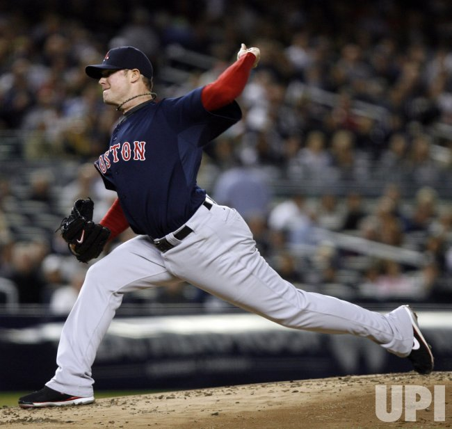 Boston Red Sox starting pitcher Jon Lester throws a pitch against the New York Yankees at Yankee Stadium in New York