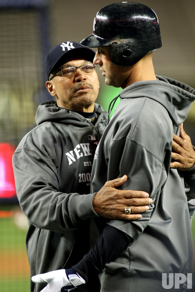 Jackson and Jeter at practice before New York Yankees take on Philadelphia Phillies in game 6 of the World Series at Yankee Stadium in New York