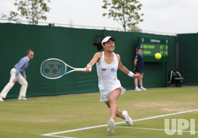 Kimiko Date-Krumm plays a forehand at 2013 Wimbledon Championships
