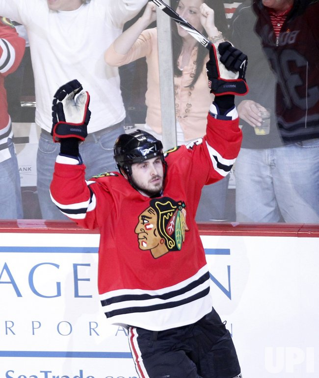 Blackhawks Bolland celebrates goal against Sharks in Chicago