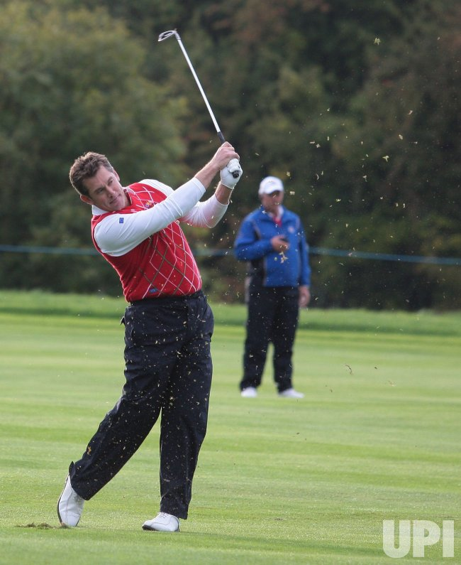 Westwood hits a fairway shot on the first day of Ryder Cup.
