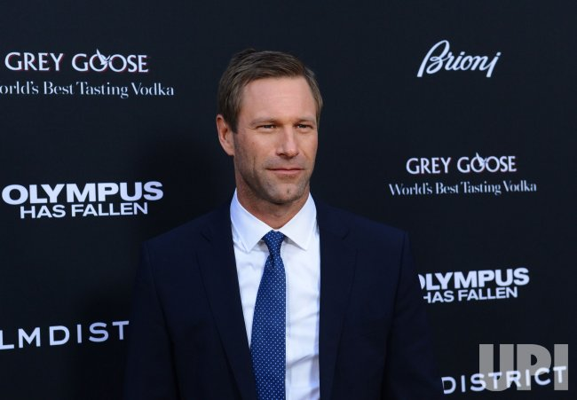 "Aaron Eckhart attends the ""Olympus Has Fallen"" premiere in ..."
