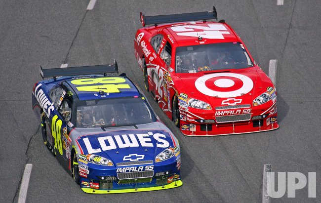 Jimmie Johnson battles with Juan Juan Pablo Montoya during the running of the NASCAR TUMS Fast Relief 500.