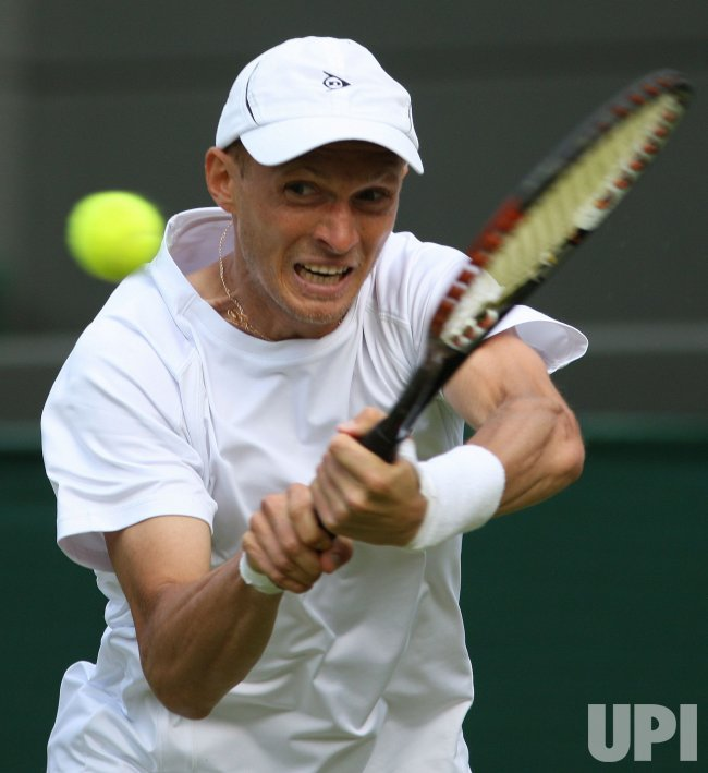 Nikolay Davydenko plays a bckhand on the first day of Wimbledon.