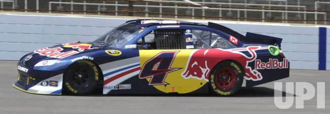 Kasey Kahne, driving the Red Toyota, leads early during the Brickyard 400