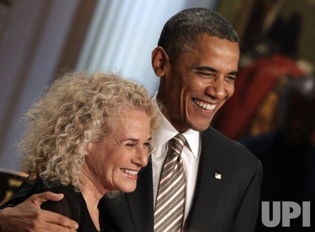 President Barack Obama awards singer-songwriter Carole King the 2013 Library of Congress Gershwin Prize