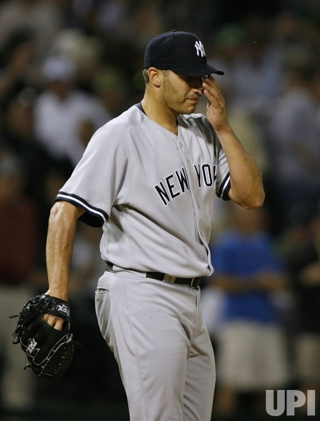 New York Yankees starting pitcher Andy Pettitte gives up a run against the Chicago White Sox