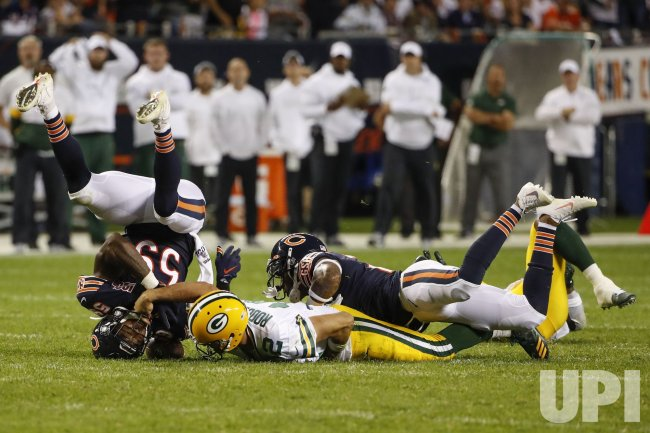 Packers quarterback Aaron Rodgers is tackled in Chicago