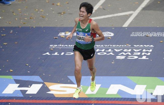 Yuki Kawauchi crosses the finish line in New York Marathon ...