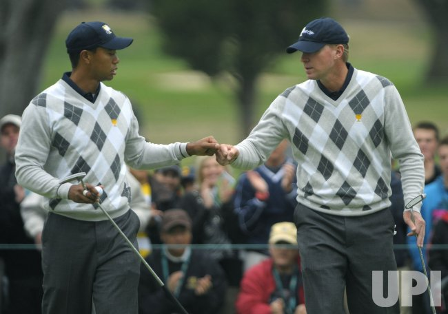 Tiger Woods and Steve Stricker celebrate during the third round of the 2009 Presidents Cup in San Francisco