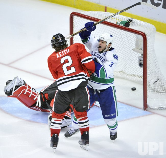 Canucks Bieksa celebrates goal against Blackhawks in Chicago