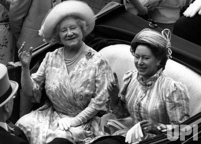 Queen Elizabeth, the Queen Mother and Princess Margaret in an open carriage.