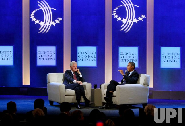 President Barack Obama and Bill Clinton discuss health care at the 2013 Clinton Global Initiative Annual Meeting in New York