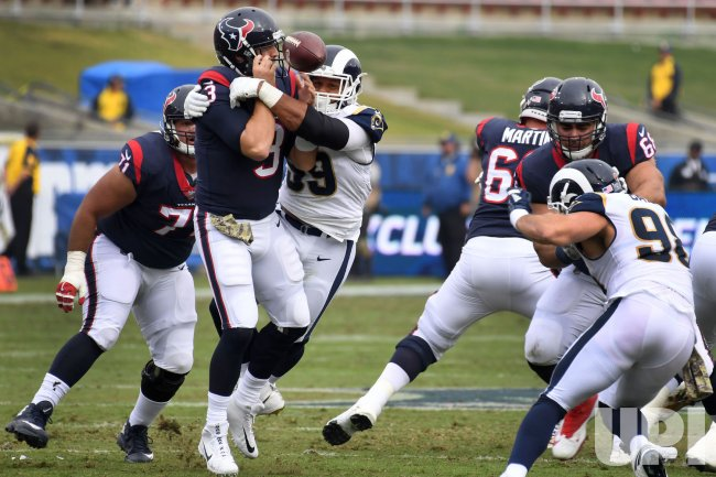 Rams' Aaron Donald (99) causes a fumble by tackling Texans quarterback Tom Savage in Los Angeles, California