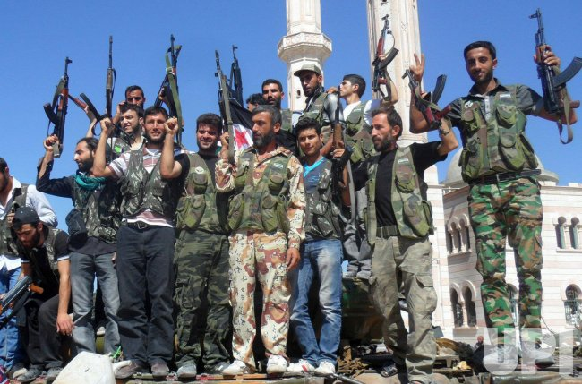 Members of the Free Syrian Army Chant slogans Against Syrian President Assad