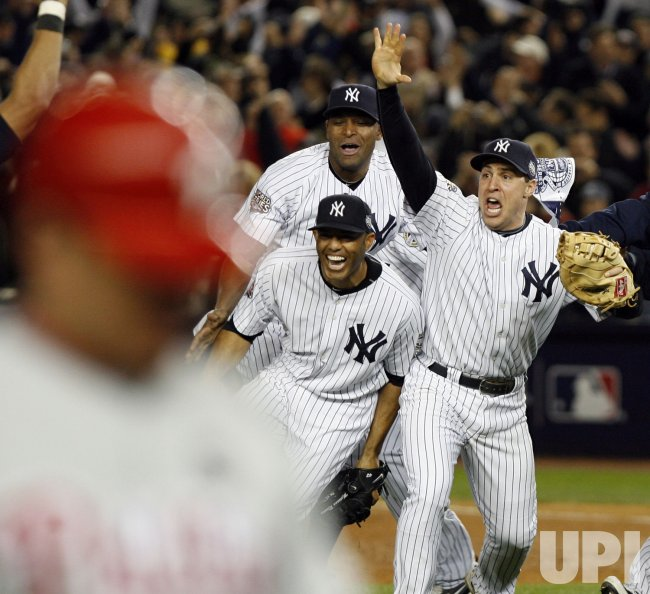 New York Yankees Mariano Rivera and mark Teixeira React after the game against the Philadelphia Phillies in game 6 of the World Series at Yankee Stadium in New York