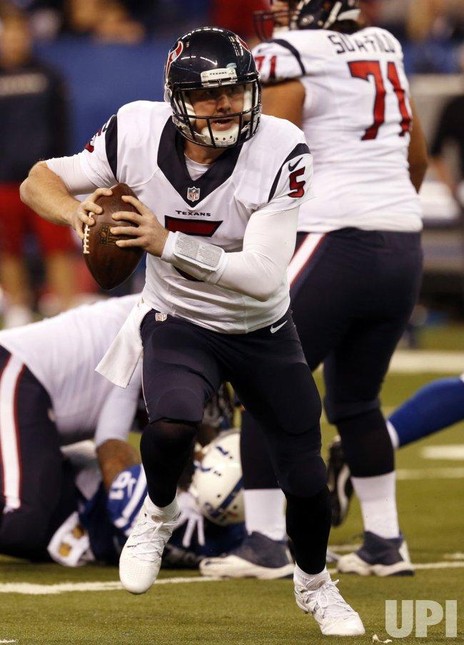 Texans QB Brandon Weeden runs under pressure