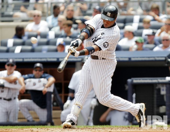 New York Yankees Robinson Cano hits a 2-run homer at Yankees Stadium in New York