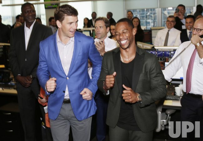 Victor Cruz and Eli Manning at BTIG Charity Day in New York